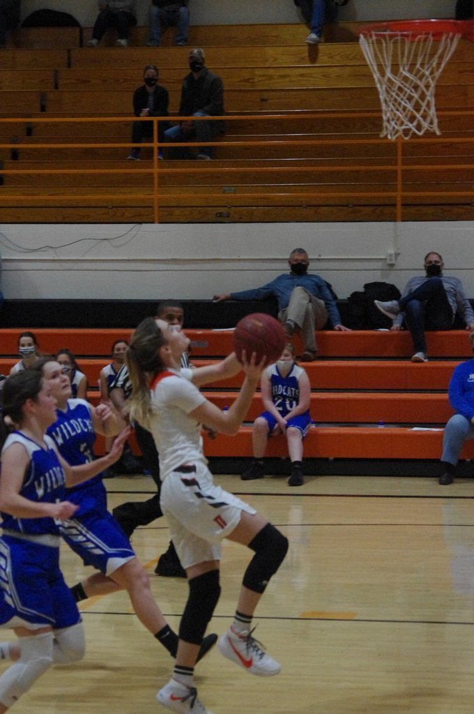 Picture of Danielle Howard scoring a basket against Yates Center.