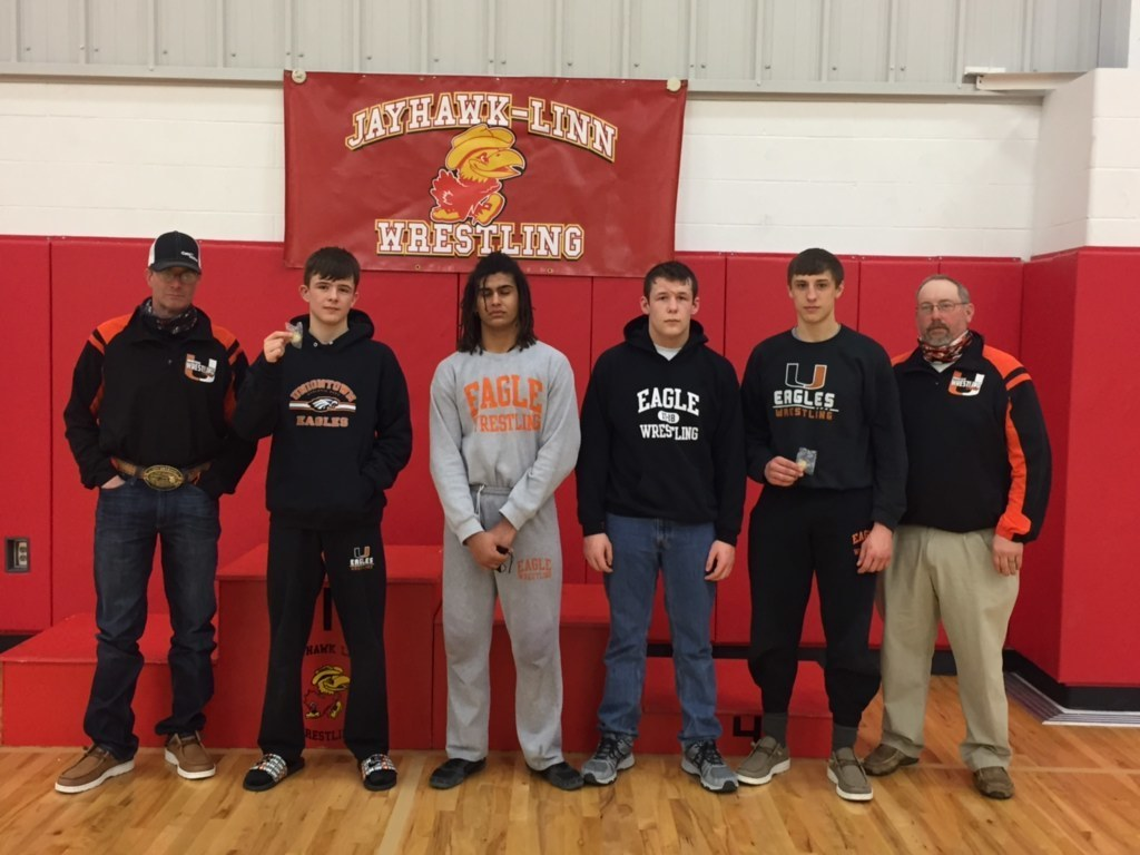 Picture of HS Wrestlers at Districts. Coach Andy Eck, Kane Shepard, Cayman Fewell, Dawson Bolinger, Bryce Eck and Coach Willie Hathaway
