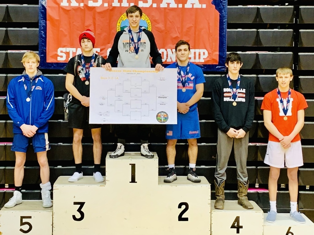 3-2-1A 152lb State Champion Bryce Eck on the medal stand in Hays, Kansas