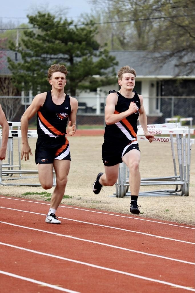 Dawson Dreisbach and Ian McClure running in the 100M Dash