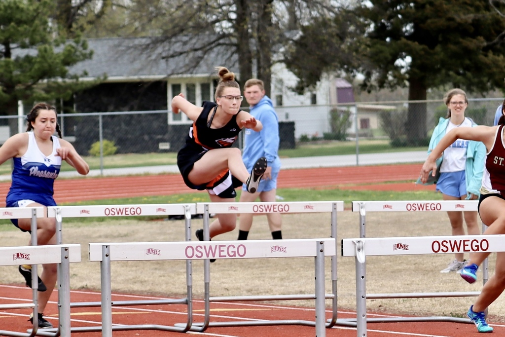 Addi Martin running the 100M Hurdles