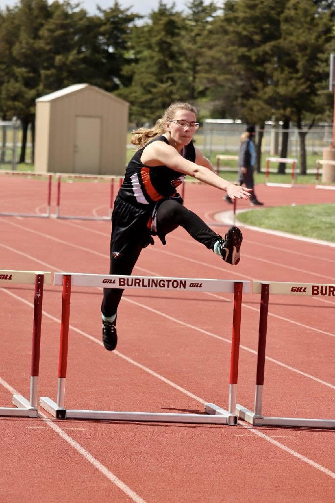 Addy Martin running the 300 Intermediate Hurdles
