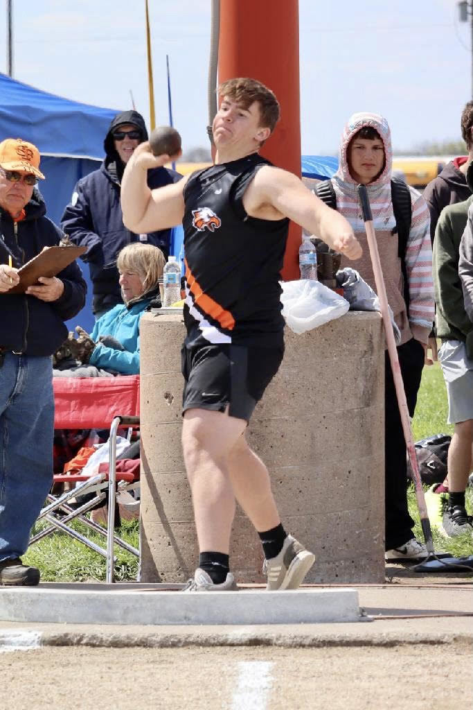 Korbin Miller throwing the shot put.
