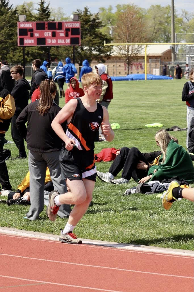Levi Snider running in the 1600M Run
