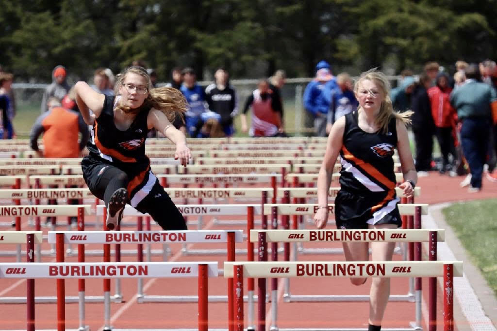 Addy Martin and Adysin McCarley running in the 100M Hurdles.
