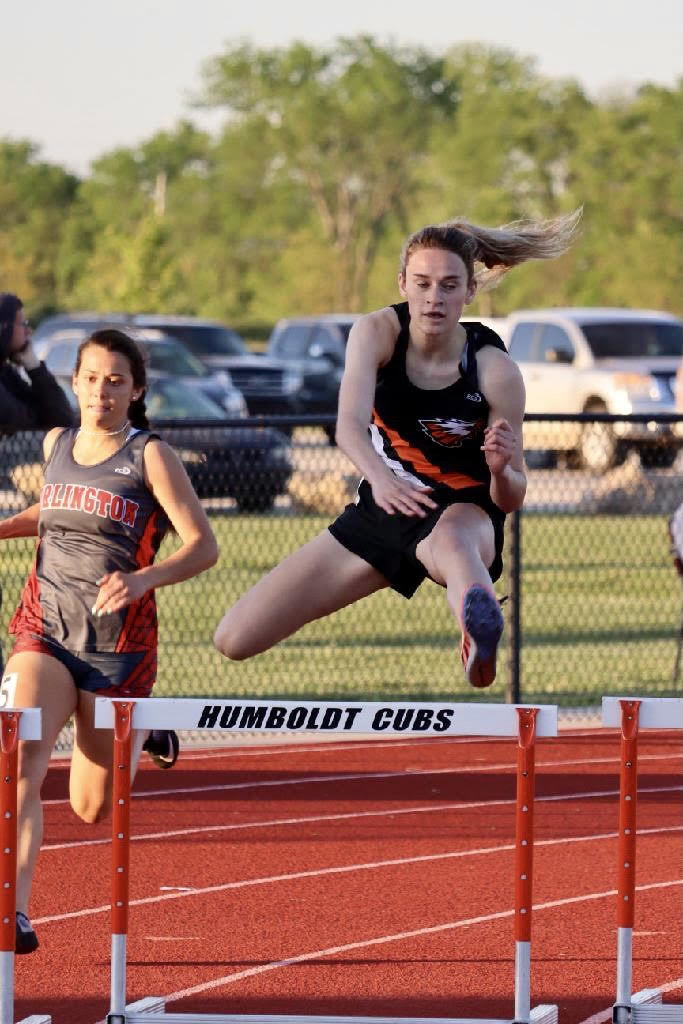 Danielle Howard running the 300M Intermediate Hurdles