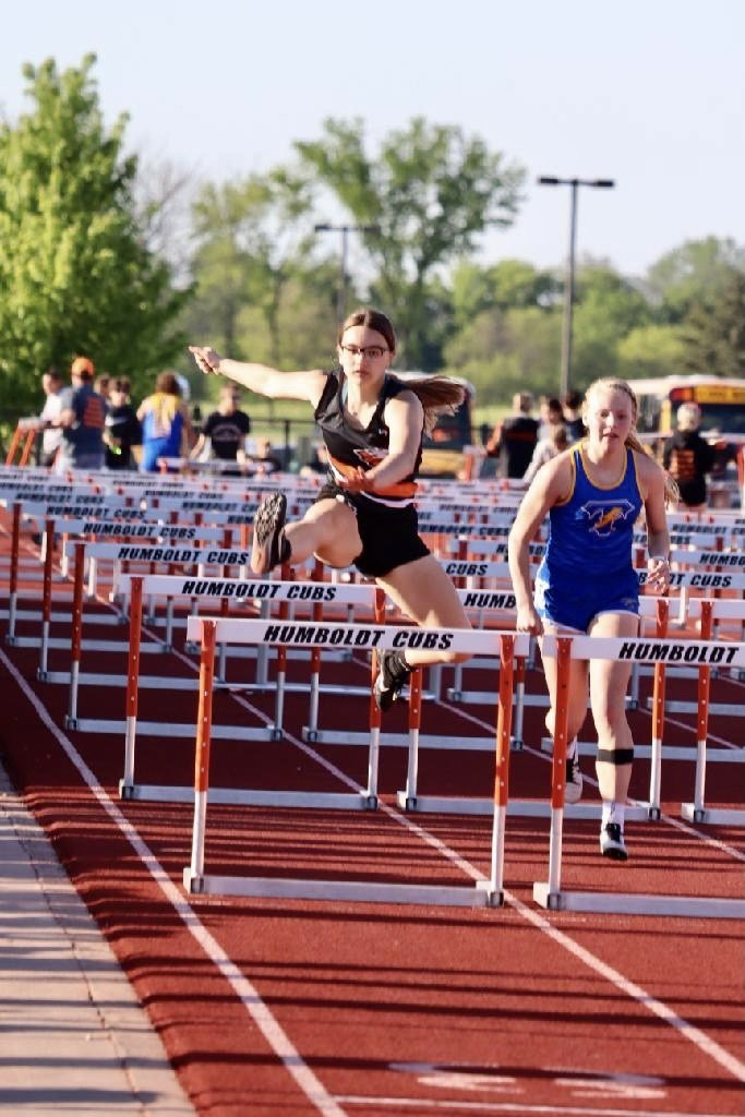Brooklynn Dreisbach running the 100M Hurdles