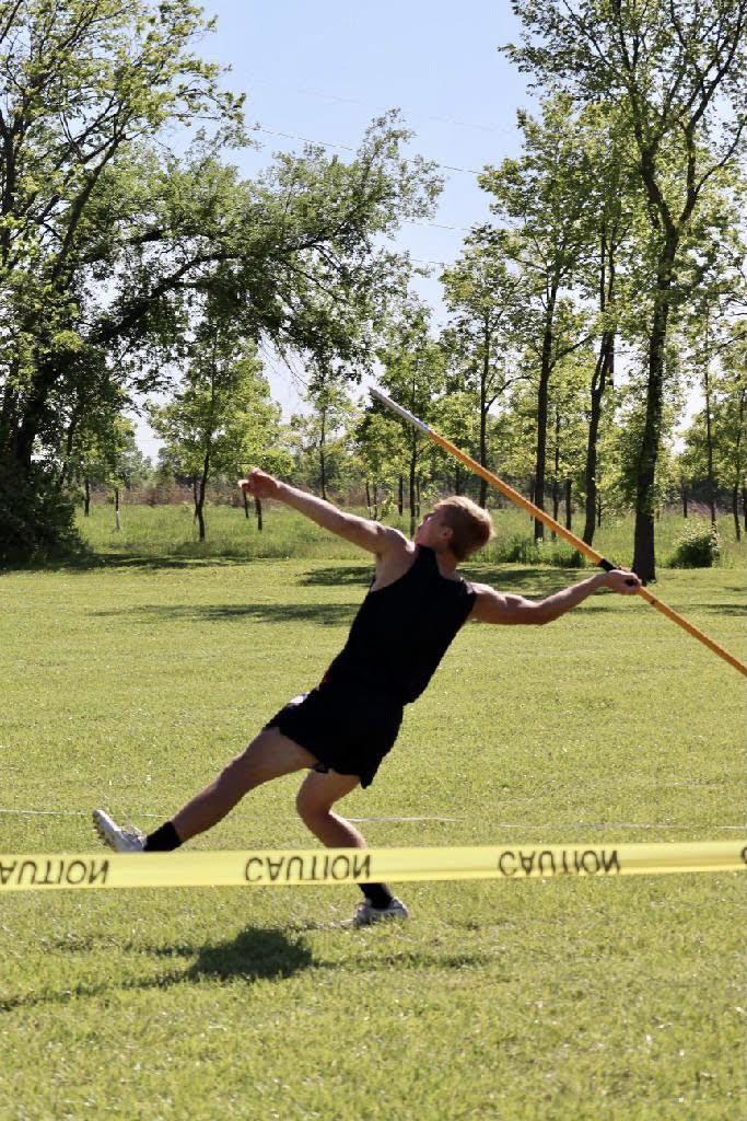 Caleb Davis throwing the Javelin.