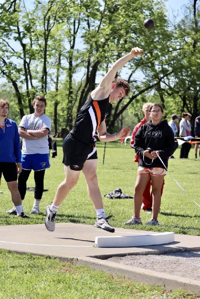 Ian McClure throwing the Shot Put.