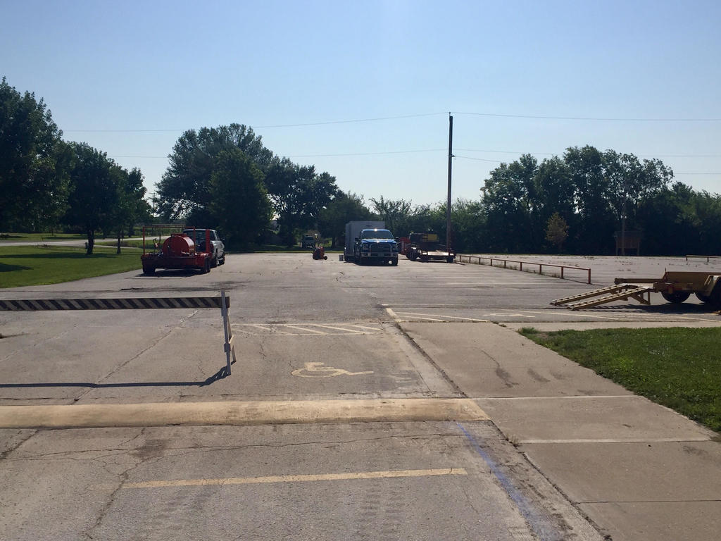 Bailey's Asphalt Company pulling into WBE parking lot to begin work.