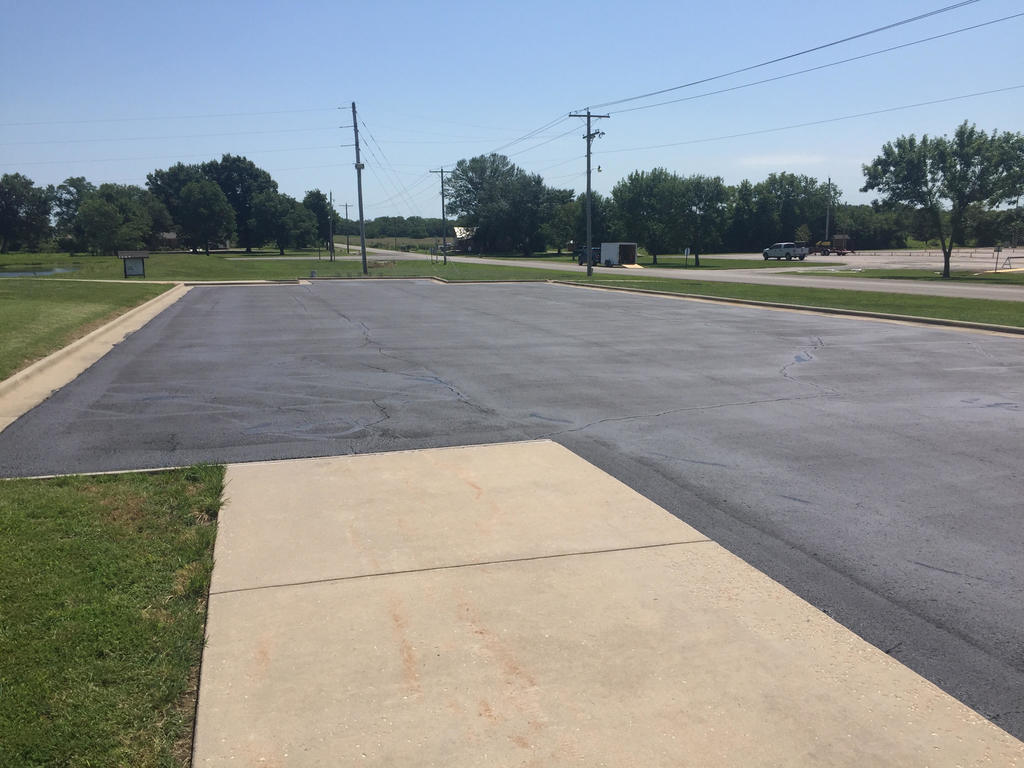 Parking lot south of Fitness Center has first coat of sealer applied.