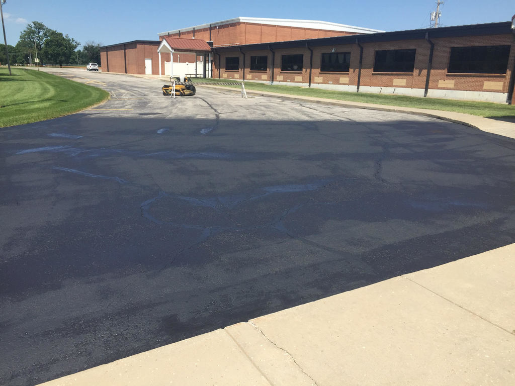 HS Drive is underway.  They will have first coat of full drive completed today.