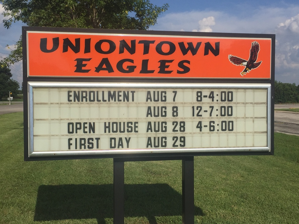 Sign at USD 235 showcases upcoming important dates for enrollment, open house and the first day of school.