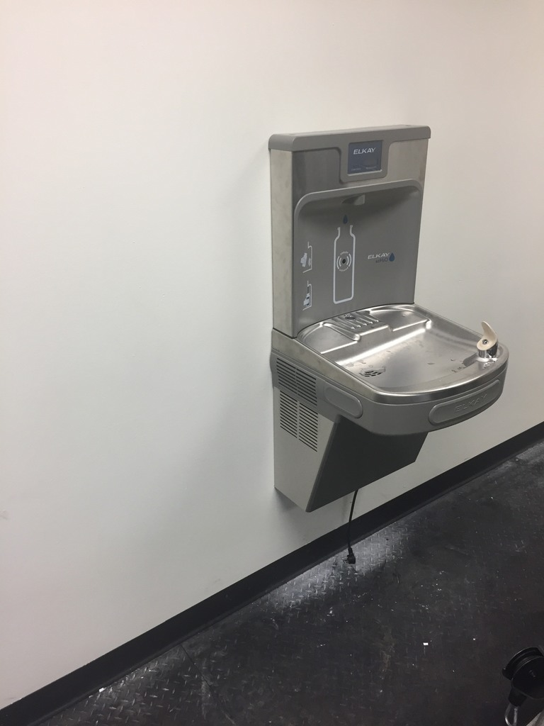 Water fountain with bottle filler is installed and ready for use.