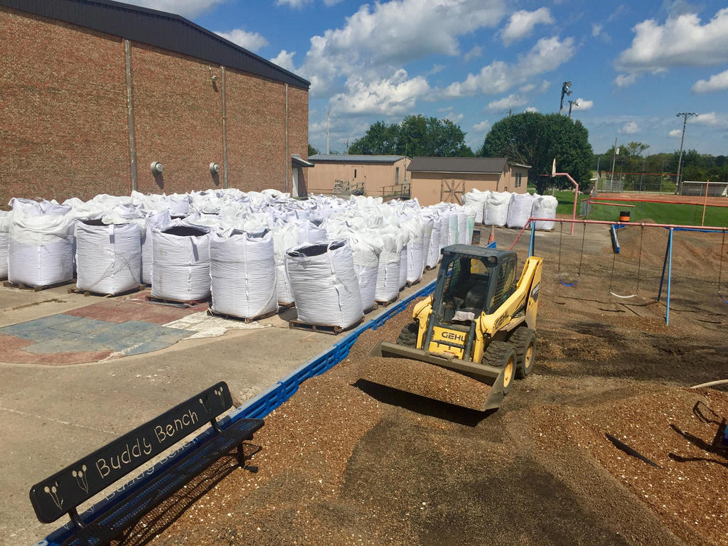 1 ton sacks of recycled rubber is ready to be put on WBE playground.