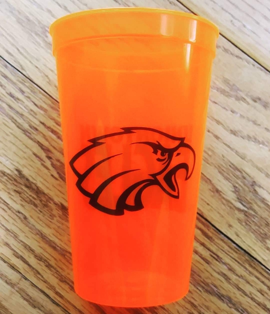back of neon orange 20oz stadium cup with Uniontown eagles logo