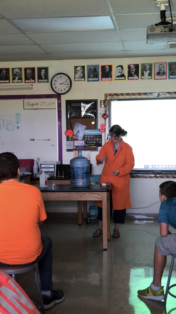 8th grade science watching a combustion reaction demonstration by Mars. Weston.