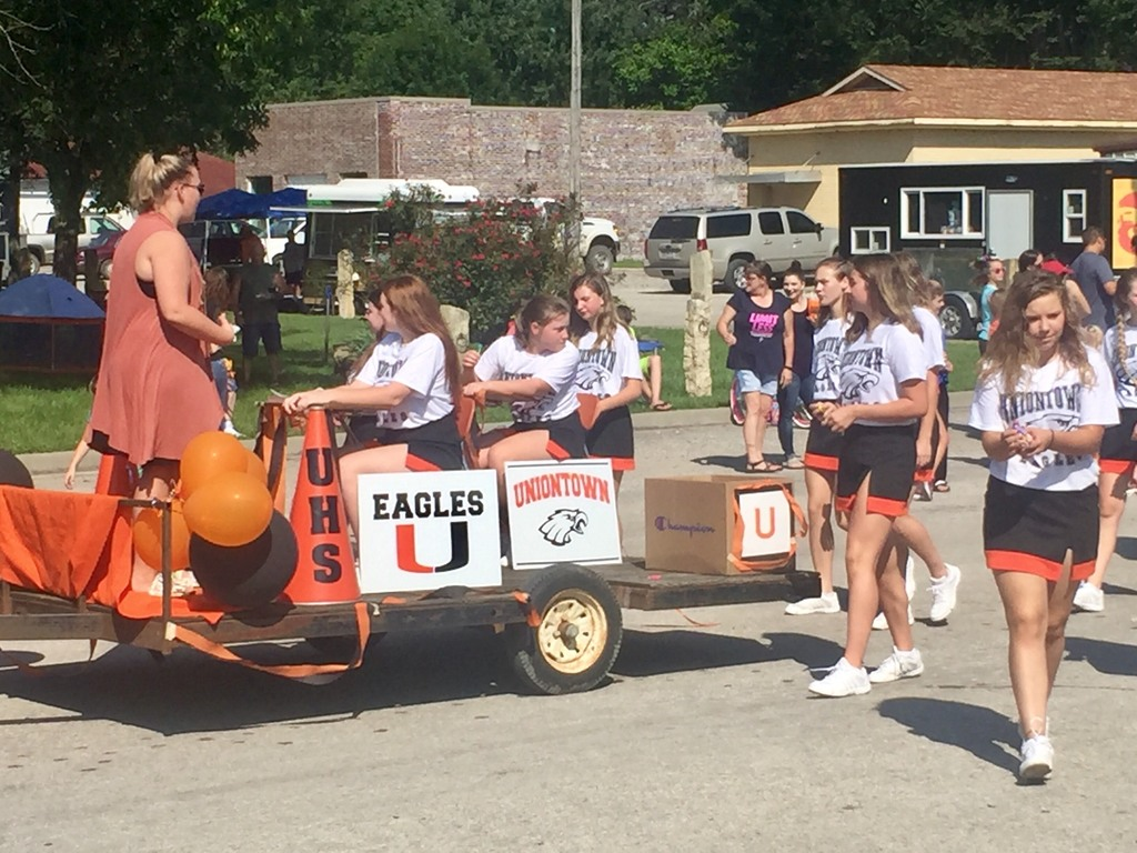 Members of the Uniontown HS Cheerleading Squad riding a float in the Old Settler's Day Parade.