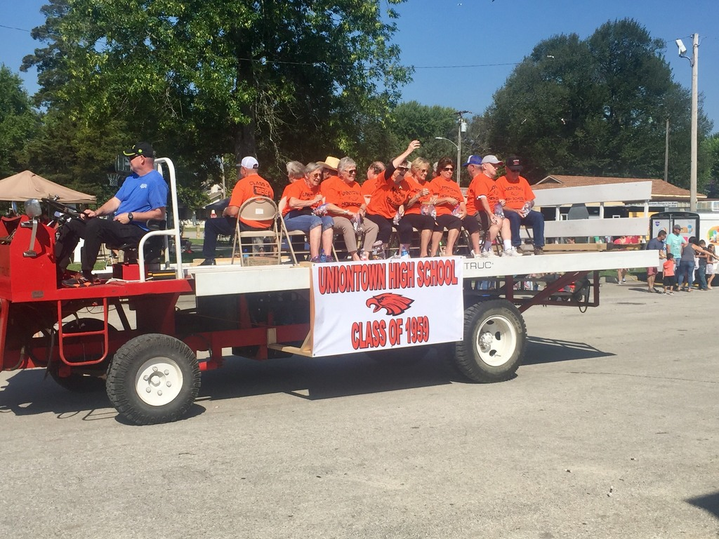 Members of the Uniontown HS Class of 1959 ride on a hay monster in the Old Settler's Day Parade.