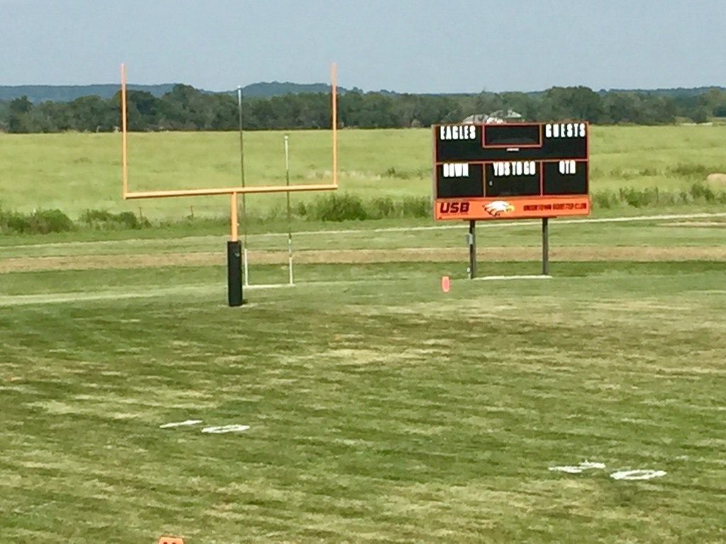 Picture of Football Field with scoreboard in the background.