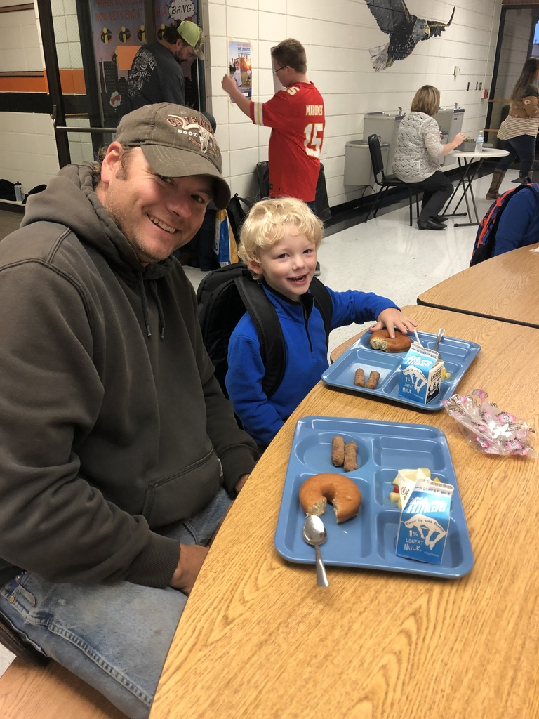 Student eating with their dad.