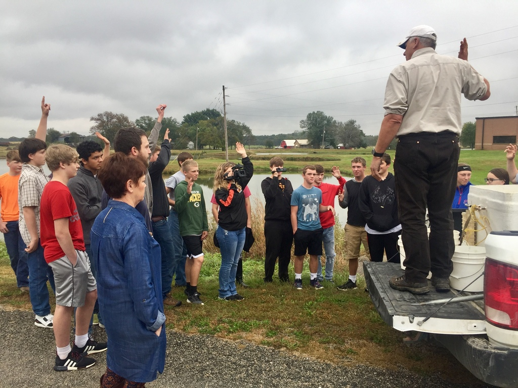 Don George, Fisheries Biologist speaking with Uniontown students about the stocking process.
