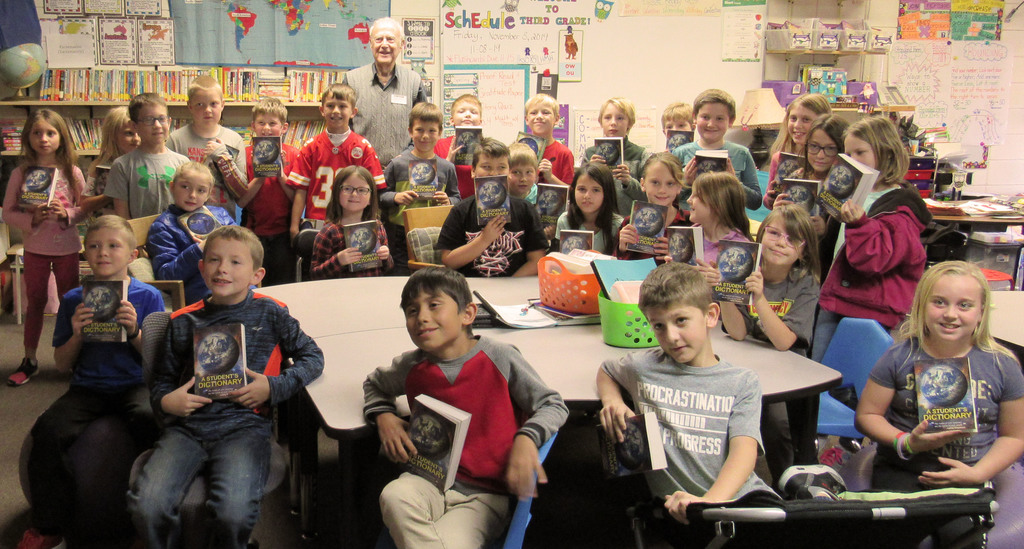 All third grade students and Mr. Lyons with their dictionaries dontated by the Rotary Club.