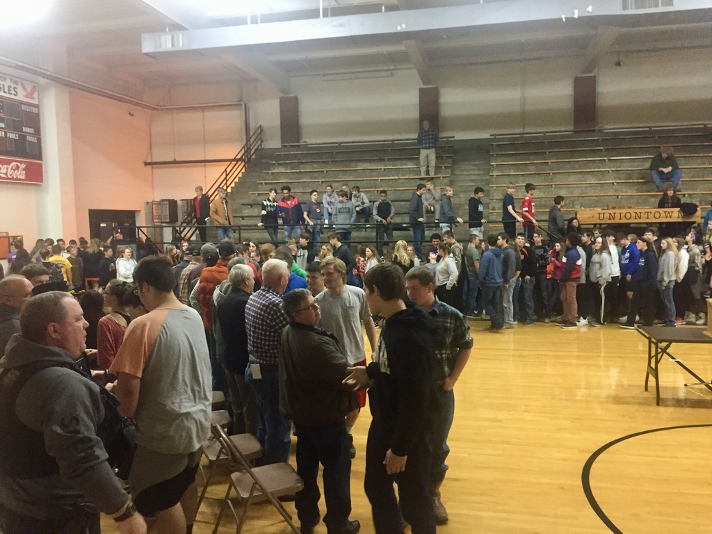 Students shaking the hands of all Veterans in attendance today thanking them for their service.