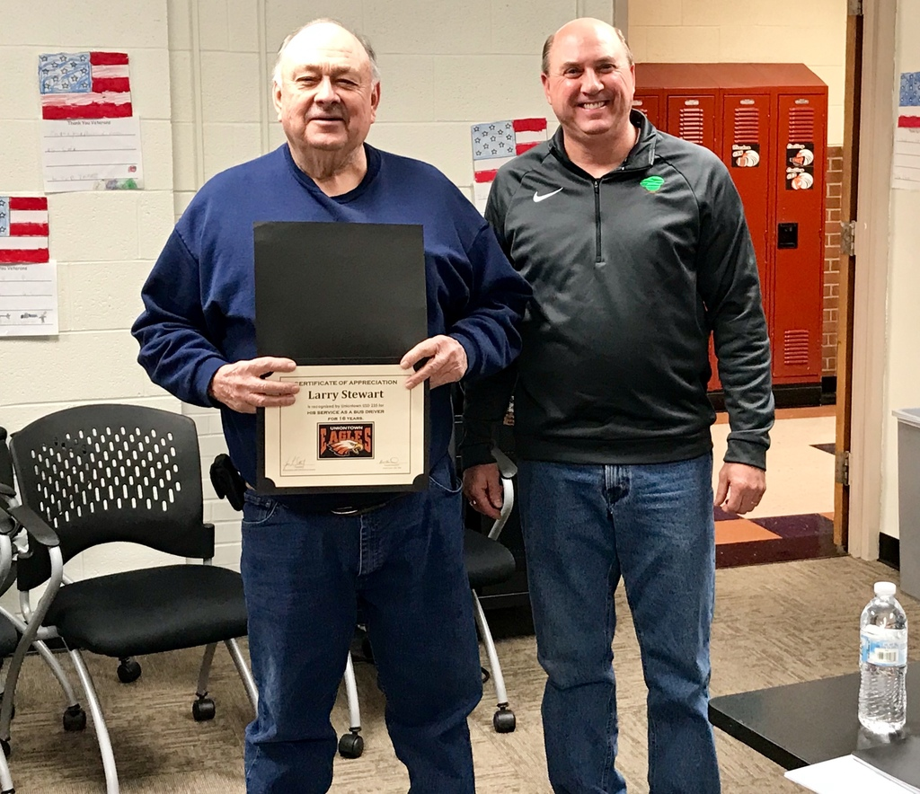 Mr. Reith awarding Larry Stewart a Certificate of Recognition for driving a bus for USD 235 for over 16 years. Larry retired in October.