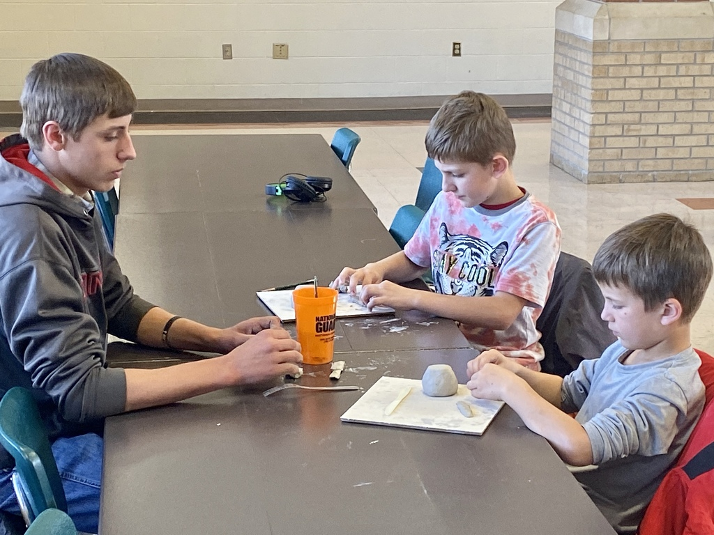 WBE students working on clay project