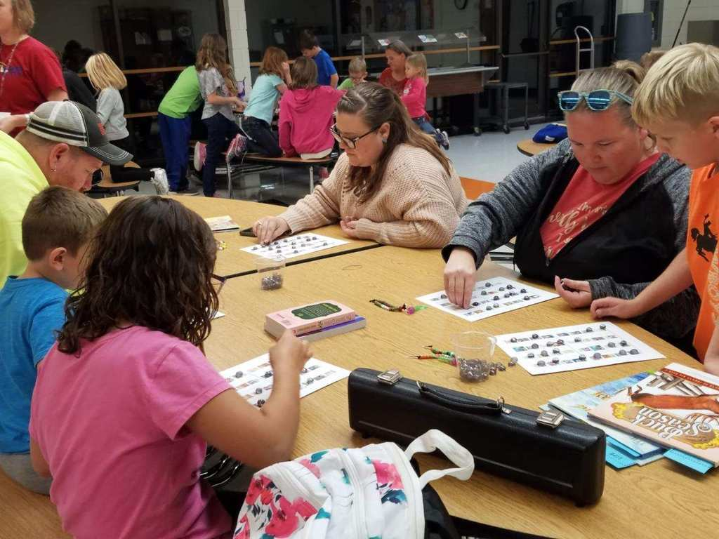 Families playing book bingo for free books