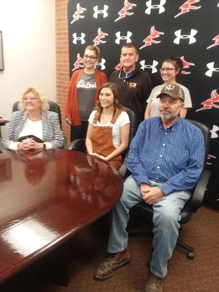 Sivanah with her parents, cheer coach, and Athletic Director at the signing of her letter of intent to Cheer.