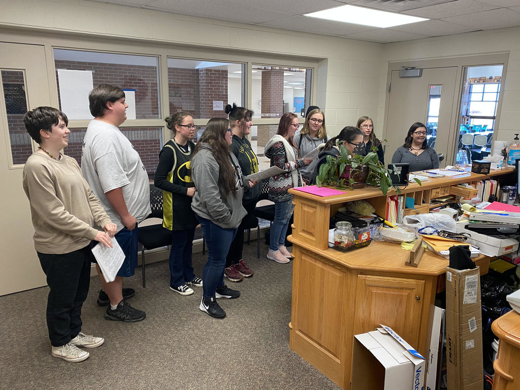 Members of HS Choir stopped by the district office to sing carols.