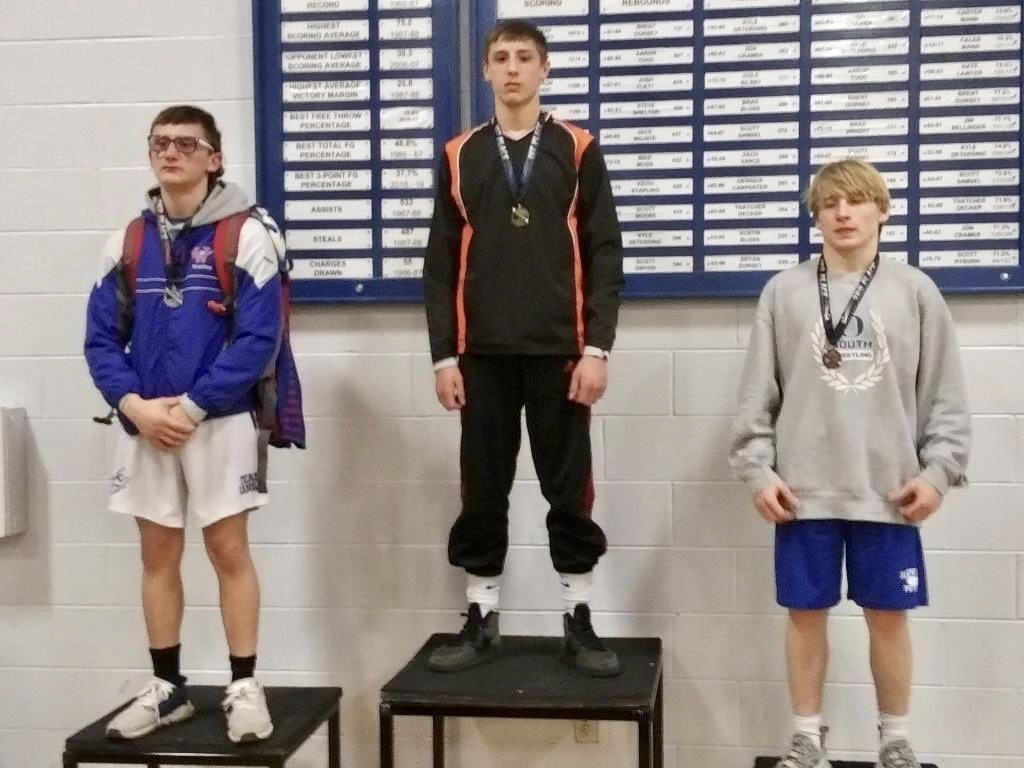 Bryce Eck on the medal stand for winning the 145lb weight class.