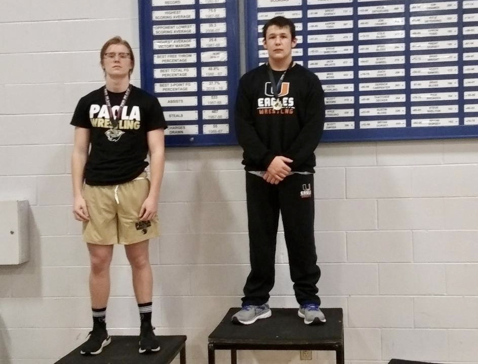 Dawson Bolinger on the medal stand for winning the 195lb weight class.
