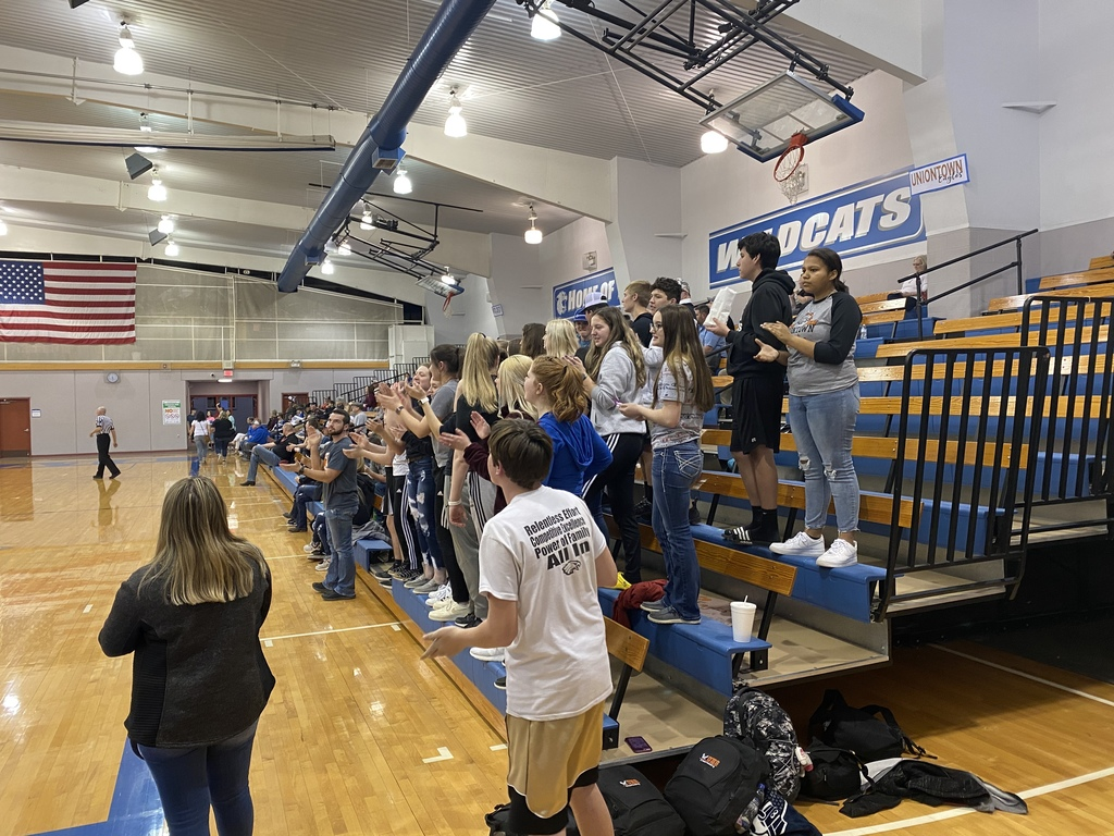 Student section cheering on the HS Boys Varsity Basketball Team against Northeast during the Sub-State Semifinal Game.