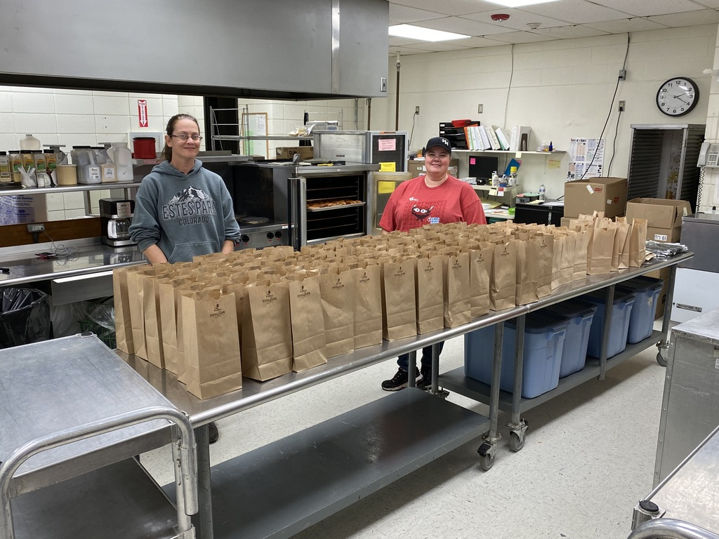 USD 235 Food Service Staff preparing sack lunches for delivery on Tuesday, March 31.