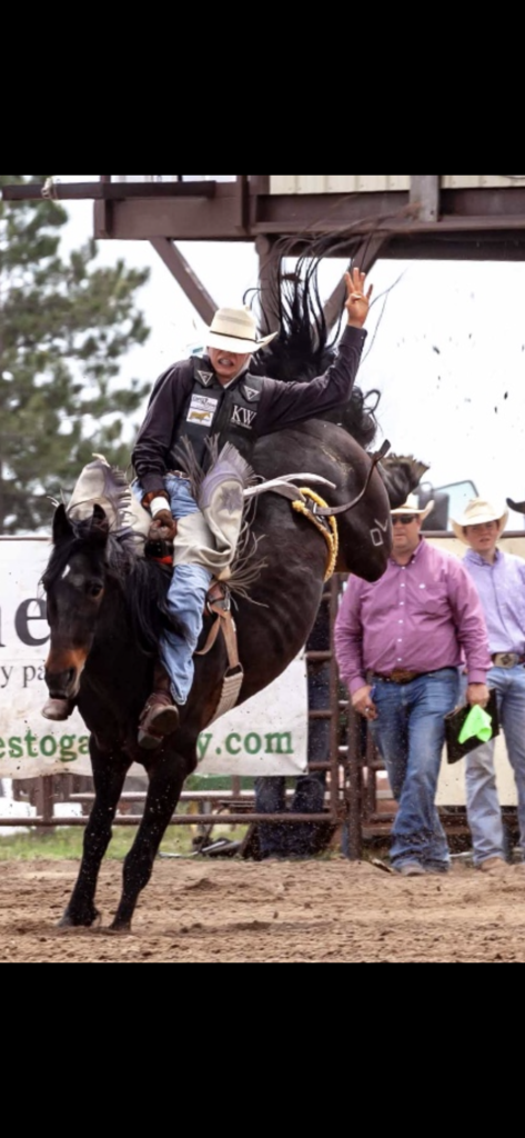 Bryce Eck riding bareback in a rodeo