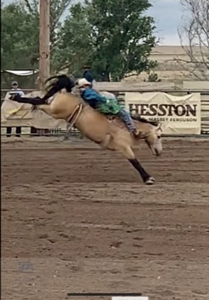Bryce Eck riding bareback during rodeo competition.