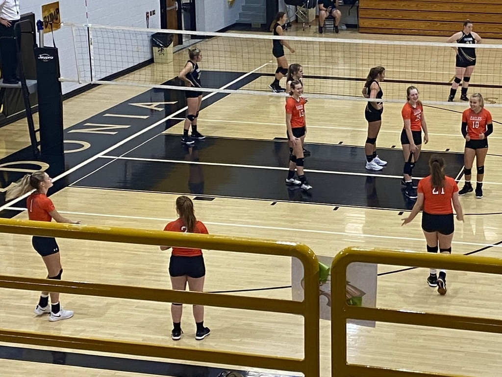 The Varsity volleyball team preparing to play Fredonia