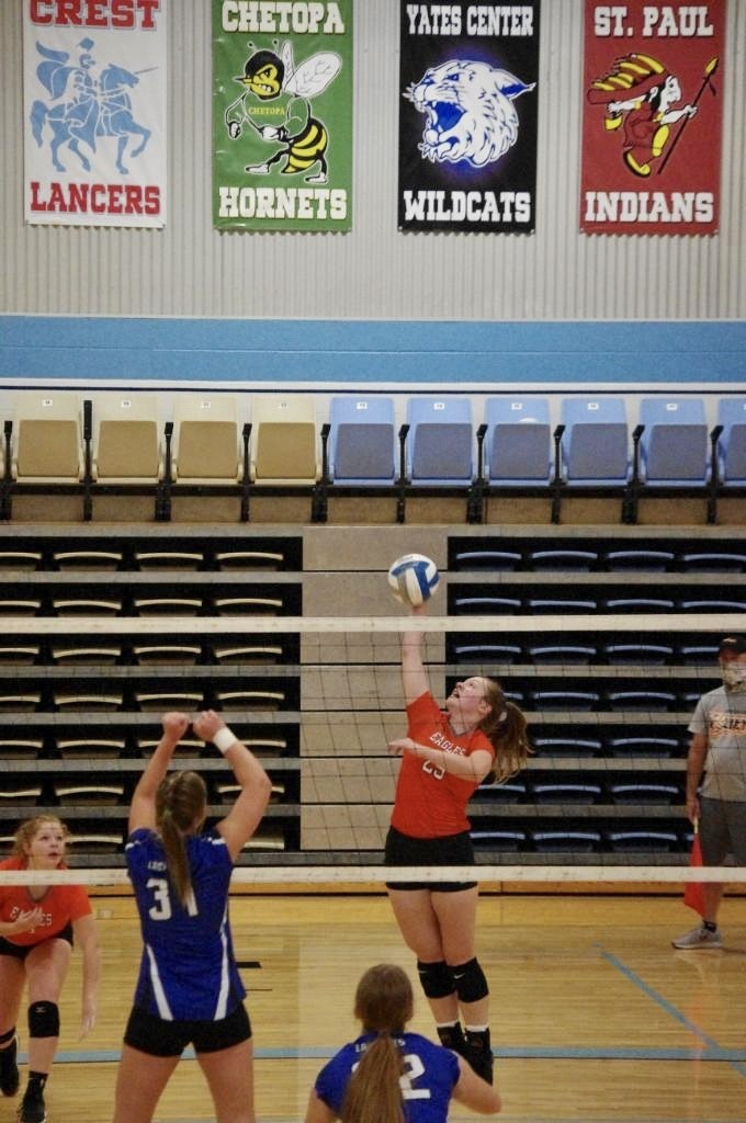 Picture of Karleigh Schoenberger going for a kill against Yates Center