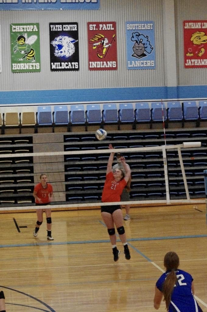 Picture of Libby Schaff going for a kill against Yates Center