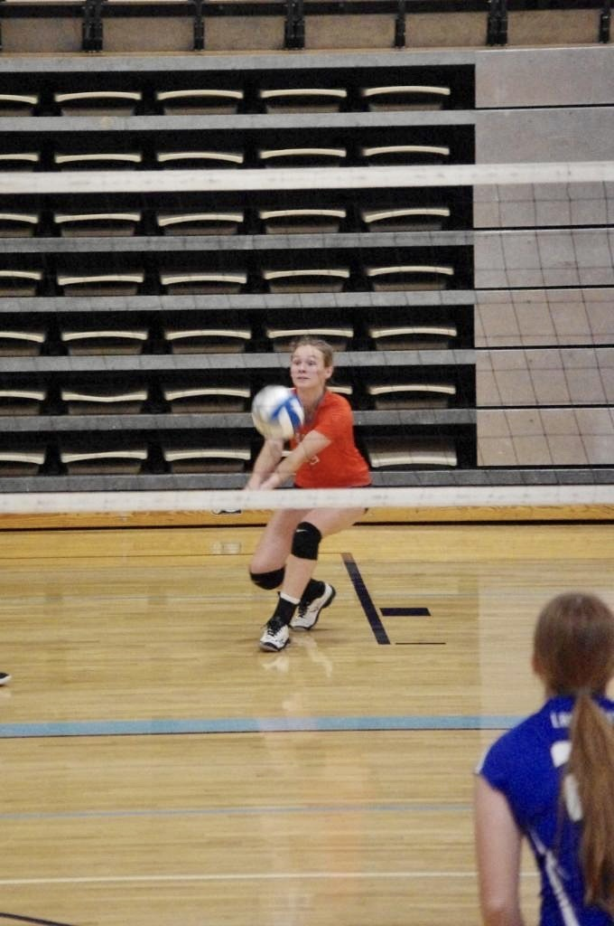 Picture of Paige Mason passing the ball for a good set against Yates Center